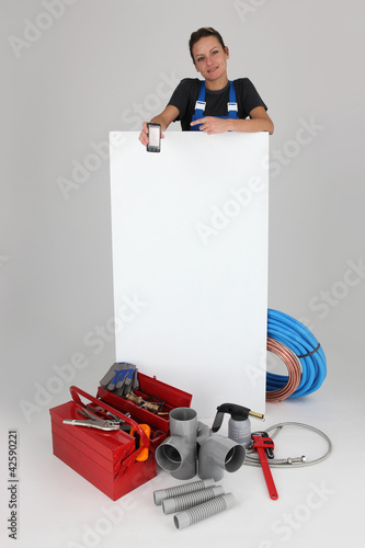 tradesman holding, mobile, phone