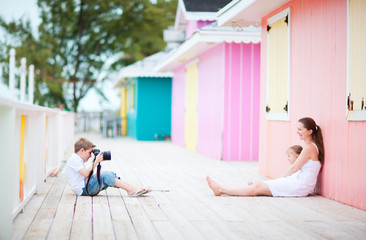 Little boy photographing his family