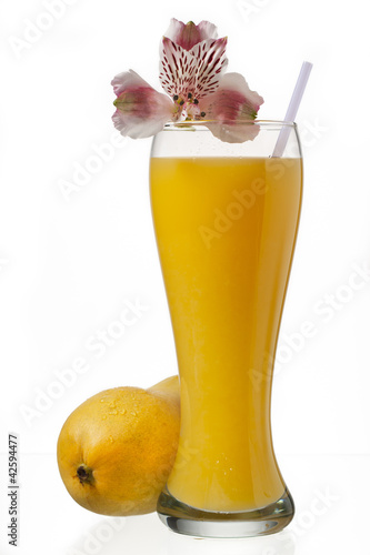 glass of mango juice and decorated with flowers