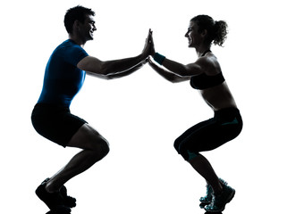 man woman exercising squatts workout fitness