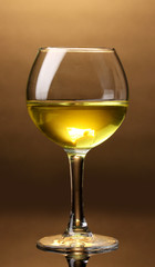 Wineglass on brown background