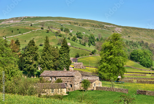 Stone barns in English countryside