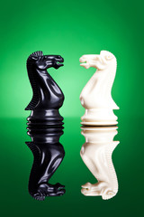 white and black knights facing aeach other