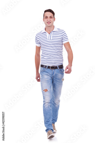 Casual Man is walking towards the camera