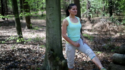 Two women exercising and stretching in the forest, steadycam