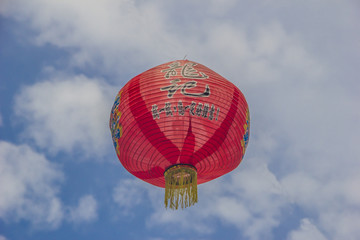 Chinese lamp on the sky background