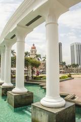 A view of Merdeka Square in Kuala Lumpur through white columns