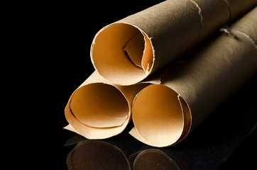 Many scrolls isolated on a black
