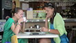 Two female friends chatting in cafe, steadicam shot