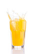 splash in glass of orange soda with ice cubes