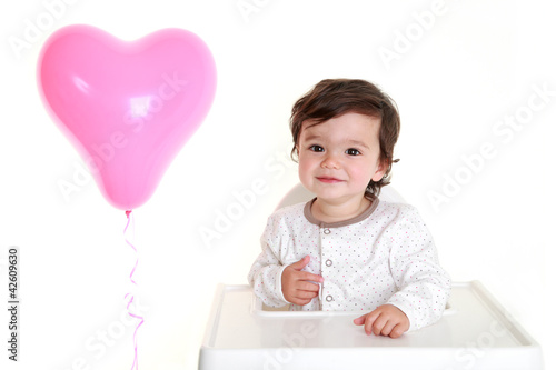 Adorable baby with heart shaped balloon