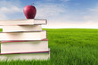 Books with apple outdoor