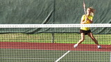 Girl playing tennis in slow motion