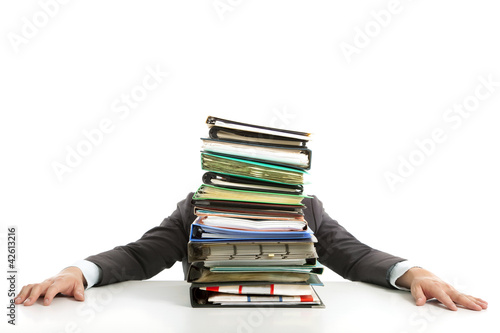 tired Businessman hiding behind paperwork