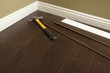Hammer, Laminate Flooring and New Baseboard Molding