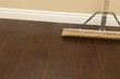 Push Broom on a Newly Installed Laminate Floor and Baseboard