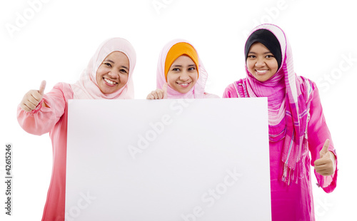 muslim women holding a white board