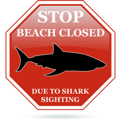 Beach closed due to shark sighting red sign.