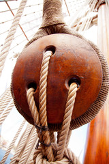 Ancient wooden sailboat pulleys and ropes