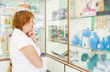 Mature woman r in pharmacy