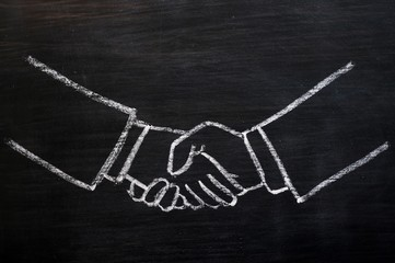 Chalk drawing of handshaking on a blackboard