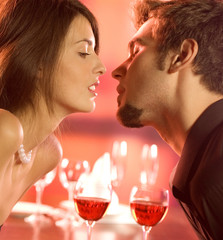 Couple kissing on romantic date