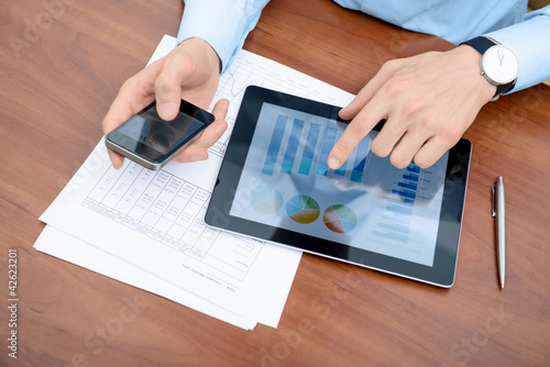 Businessman analyzing information on a modern devices
