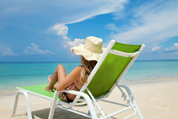 Woman relaxing on a beach