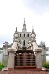 White stupa in a pond, STOU university, Thailand