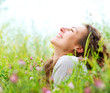 Beautiful Young Woman Outdoors. Enjoy Nature. Meadow
