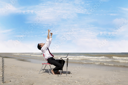 Successful businessman at beach