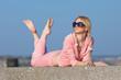 Woman in pink sportswear lying on front
