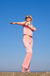 Girl in pink sportswear dancing outdoors