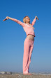 Young woman in pink sportswear doing gymnastics
