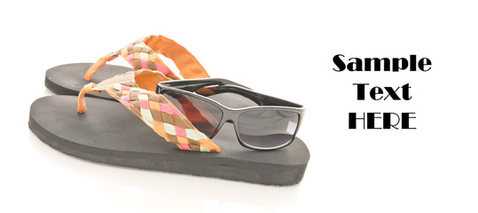 Flip Flops and Sun Glasses with Space for Text on white