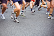 People running marathon on city street