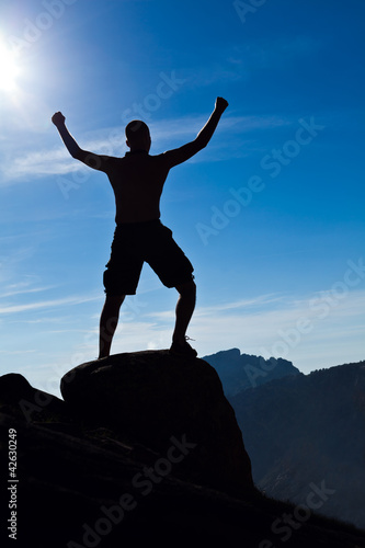 Man climbing in mountains