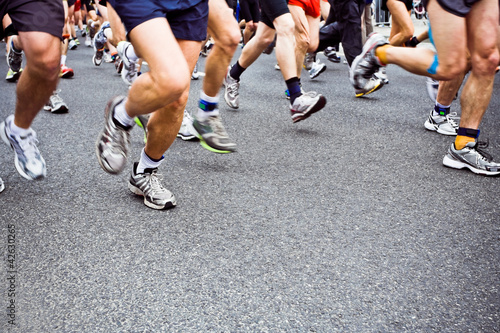 People running marathon on city street