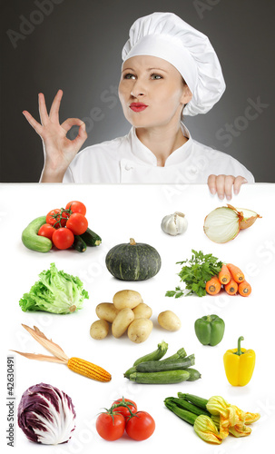 Female chef with vegetable collection