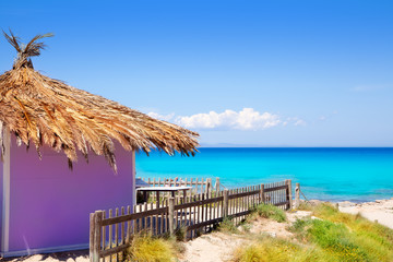 Formentera tropical purple hut on turquoise beach