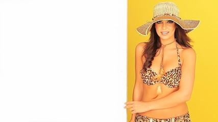 Young girl in a bikini holding a board