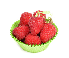 raspberries in paper form on white background