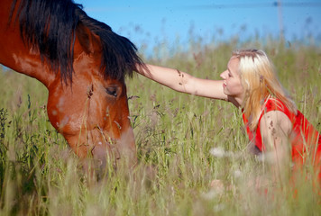 Girl and horse in the field
