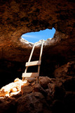 Barbaria cape cave hole with rustic ladder on wood