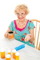 Smiling Senior Woman Takes Medicine