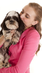 pink jacket woman kiss dog