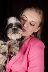 woman pink jacket kiss dog