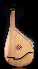 Retro bandura- Ukrainian musical instrument on black background
