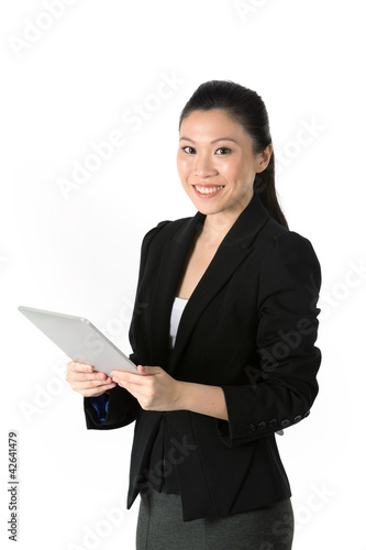 Happy Asian woman using touching screen PC