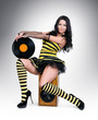 Glamorous sexy young girl with vinyl on speaker